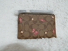 Picture of Coach Signature Canvas Corner Zip Wristlet with Smooth Leather